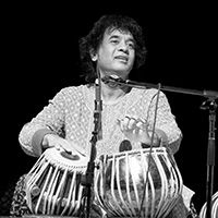 "<font style=""color:#1294d8;""><b>Zakir Hussain and the Masters of Percussion</b></font>"
