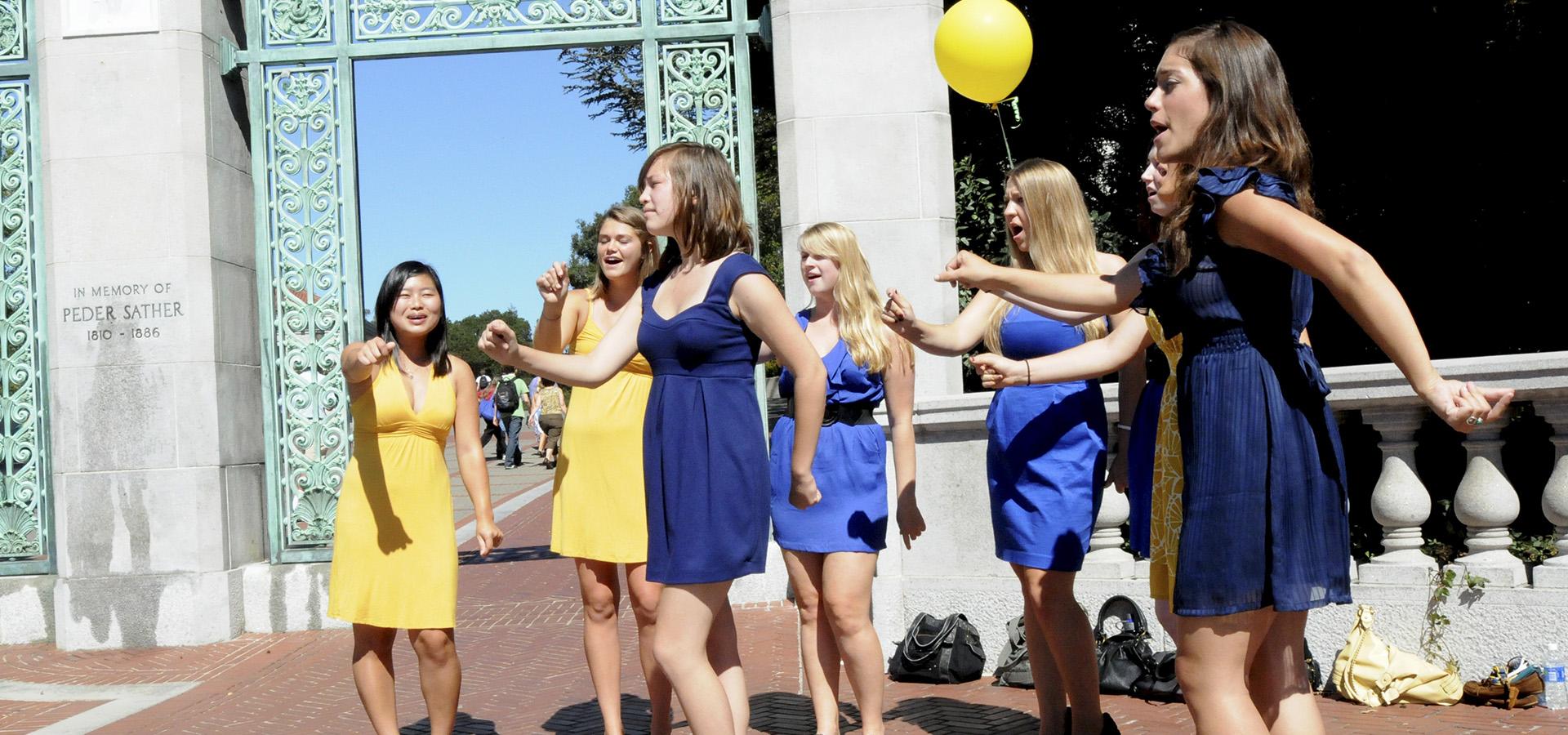 Students in dresses dancing